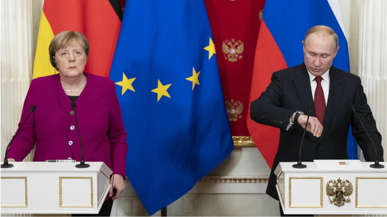 Russia's President Vladimir Putin (R) and Germany's Chancellor Angela Merkel (L) attend their joint press conference after their meeting at the Kremlin in Moscow, on January 11, 2020.