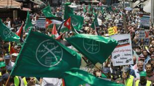 صورة من تظاهرة من تنظيم الإخوان المسلمين في الأردن احتجاجا على الخطة الأميركية للسلام في الشرق الأوسط في 21 حزيران/يونيو 2019