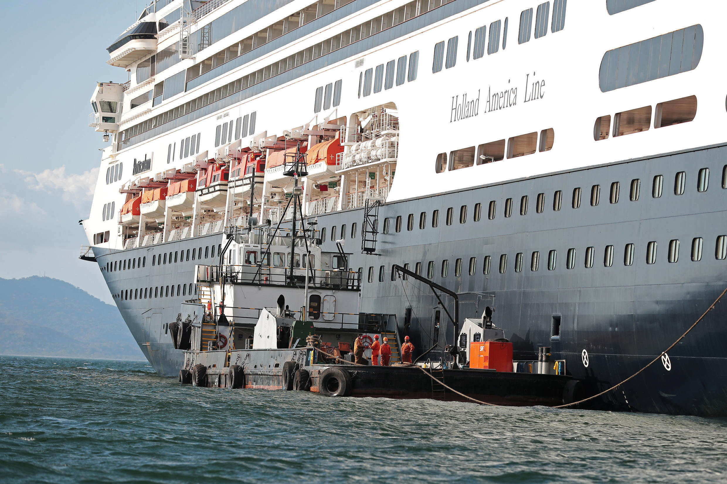 An offshore supply vessel is seen next to the cruise ship MS Rotherdam, which brought supplies and Covid-19 test kits to the MS Zaandam, where four passengers died, pictured off the coast of Panama City, Panama March 27, 2020.