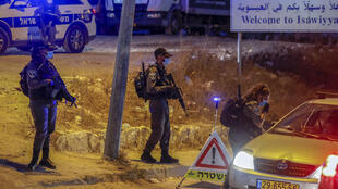 Israeli police guard a checkpoint by the East Jerusalem Arab neighbourhood of Issawiya as part of a lockdown of some 40 cities across the country amid a spike in virus infections