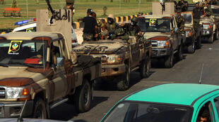 Members of the self-proclaimed eastern Libyan National Army (LNA) special forces gather in the city of Benghazi, on their way to reportedly back up fellow LNA fighters on the front line west of the city of Sirte who are facing forces loyal to the UN-recognised Government of National Accord (GNA), on June 18, 2020.