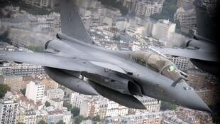Image taken from a Boeing C135 refueling tanker shows two French Rafale fighter planes, flying over the French capital during the annual Bastille Day military parade on the Champs-Elysees in Paris on July 14, 2014.
