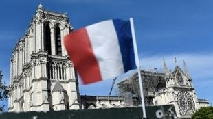 French conservatives called on the government to restore Notre-Dame cathedral exactly as it was before the fire out of respect for French heritage
