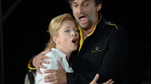 "Tenor Jonas Kaufmann (R) as Don Jose and lyric soprano Inva Mula (L) as Micaela perform during a rehearsal of the opera ""Carmen"" by Georges Bizet on July 05, 2015"