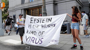 Protesters and members of the media gather outside Manhattan Federal Court during the arraignment hearing of Ghislaine Maxwell for her role in the sexual exploitation and abuse of minors by Jeffrey Epstein, New York City, July 14, 2020.