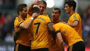 Ivan the great: Wolves midfielder Ivan Cavaleiro (2nd L) is mobbed by his team-mates after scoring the only goal of a 1-0 win away to Bristol City in the FA Cup fifth round