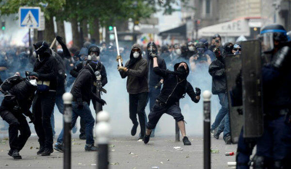 French police clash with protesters during a demonstration against labour reforms in Paris on June 14, 2016.