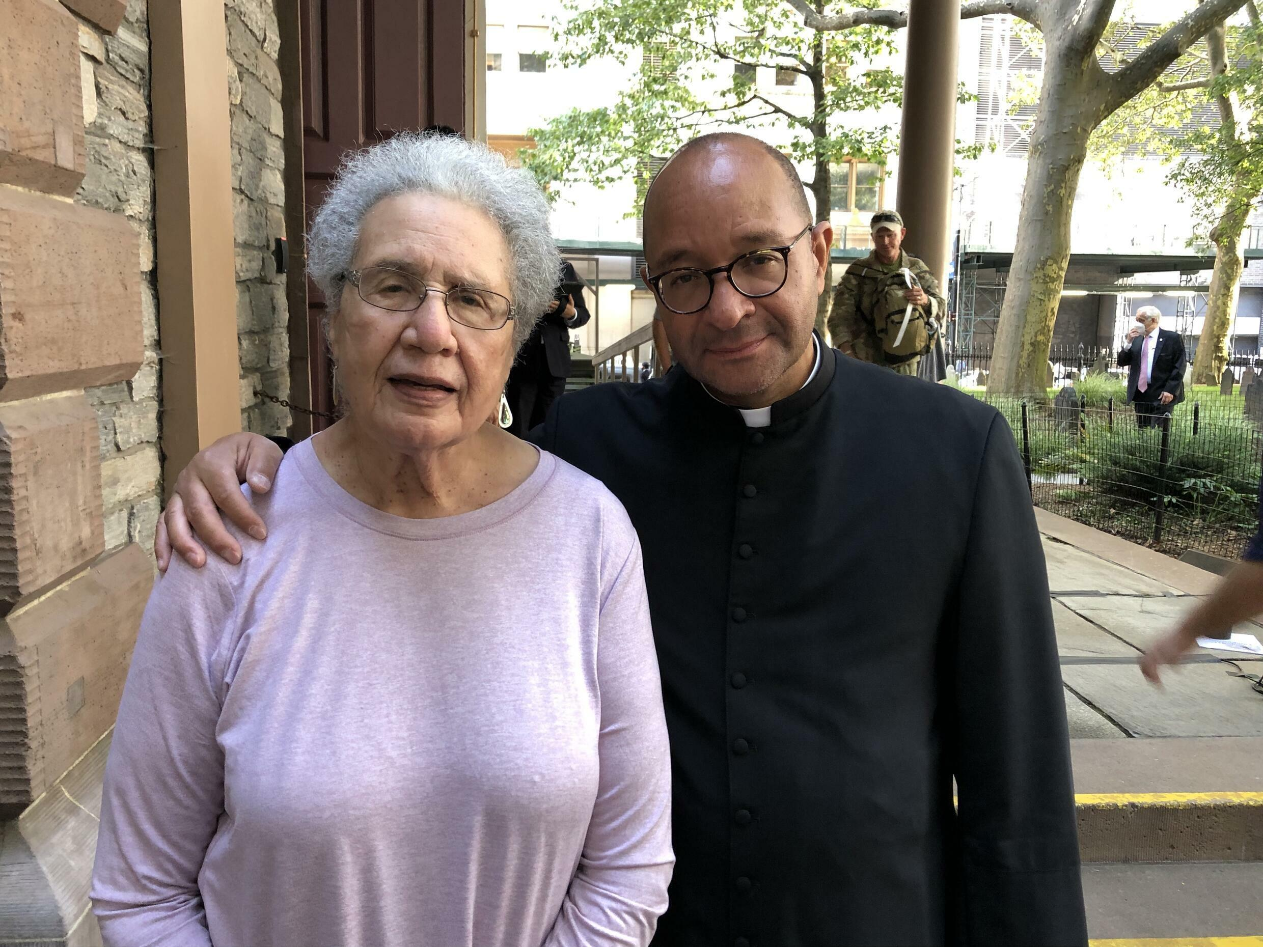 Neighbourhood resident Cynthia Moten, left, with Reverend Phillip A. Jackson, priest-in-charge at Trinity Church.