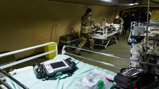 French soldiers take part in a drill at the military field hospital set up outside the Emile Muller Hospital in Mulhouse, France, March 24, 2020.