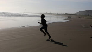 People enjoy Muriwai Beach in the wake of New Zealand easing strict regulations implemented to curb the spread of the coronavirus disease (COVID-19) near Auckland, New Zealand, April 28, 2020.