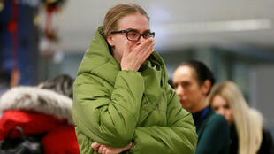 A woman reacts in front of a memorial for the flight crew members of the Ukraine International Airlines Boeing 737-800 plane that crashed in Iran, at the Boryspil International airport outside Kiev, Ukraine, January 8, 2020.