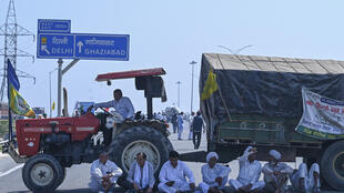 Protesters block the KMP Expressway during a roadblock-protest called by farmers, as a part of their continuing demonstration against the central government's recent agricultural reforms, at Kundli in Haryana state, on March 6, 2021.