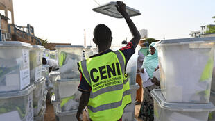 Members of Niger's Independent National Electoral Commission (CENI) prepare ballots boxes in the capital Niamey on Febuary 20, 2021.