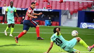 Luis Suarez completed the scoring and an impressive 20-minute debut as Atletico beat Granada 6-1