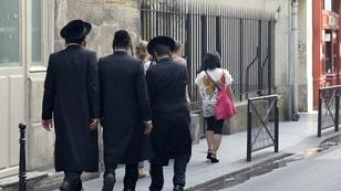 Orthodox Jews walk in the Marais district of Paris.