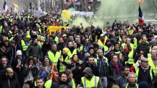 Des Gilets jaunes dans les rues de Paris, samedi 26 janvier, pour l'acte XI de leur mobilisation.