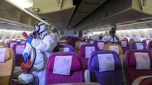 Thai Airways crew disinfect the cabin of an aircraft oto prevent the spread of the coronavirus at Bangkok's Airport, Thailand, January 28, 2020. REUTERS OK