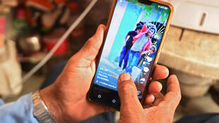 This June 30, 2020, illustration photo shows a person using the social media video-sharing application TikTok on a smartphone in Faridabad.
