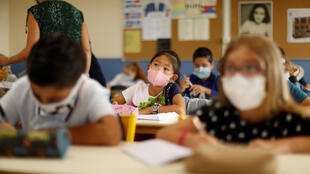 Pupils wear protective face masks at a school in Nice, in southeastern France.