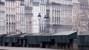 A view shows closed Paris' antique booksellers or bouquinistes along the deserted banks of the river Seine at Saint Michel district in Paris as a lockdown is imposed to slow the rate of the coronavirus disease (COVID-19) in France, March 18, 2020.