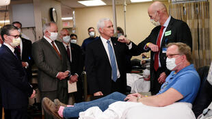Vice President Mike Pence visits Dennis Nelson, a recovered COVID-19 disease patient who is now donating his blood for research on the virus and disease as Pence tours Mayo Clinic facilities supporting coronavirus disease (COVID-19) research and treatment in Rochester, Minnesota, U.S., April 28, 2020.