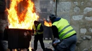 """Yellow vest"" protesters in the northern French city of Rouen, where a journalist was beaten by a crowd on Saturday"
