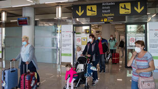 Tourists arrive in Palma de Mallorca, Spain, in June 2020 as the European Union eased coronavirus travel restrictions that remain in place for Americans who want to visit