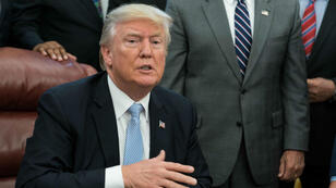 US President Donald Trump speaks to the press after signing a proclamation calling for a national day of prayer on September 3 for those affected by Hurricane Harvey at the White House in Washington, DC.