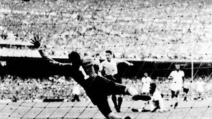 Uruguay's Juan Schiaffino scores the equalizing goal against Brazil in the decisive match of the 1950 World Cup that would forever more be known as the 'Maracanazo'