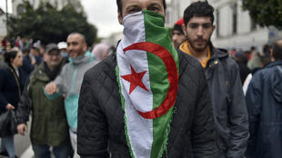 "Algerians marched in the capital on the second anniversary of the anti-government ""Hirak"" protest movement"