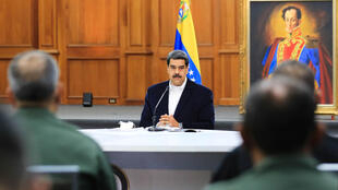 "President Nicolas Maduro, shown in a handout picture released by the Venezuelan Presidency speaking to members of the Bolivarian National Armed Forces (FANB), announced that two Americans were arrested for taking part in the failed ""invasion"""