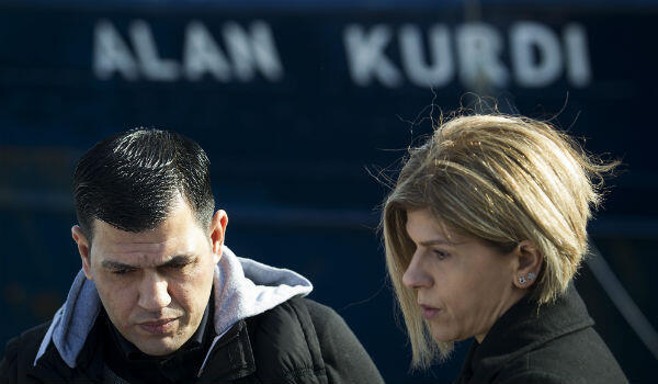 Abdullah Kurdi and his siter Tima stand in front of a Sea-Eye rescue ship named after Alan Kurdi during its inauguration in Palma de Mallorca on February 10, 2019.