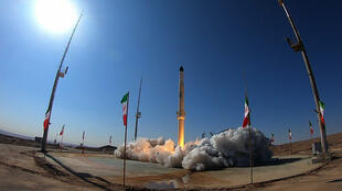 """A handout picture provided by Iran's Defence Ministry shows the launch of Iran's newest satellite-carrying rocket, called """"Zuljanah,"""" at an undisclosed location on February 1, 2021"""