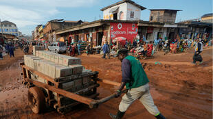 A man pulls a cart loaded with goods at the market in Butembo, in the Democratic Republic of Congo, on October 5, 2019.