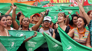 Women holding green handkerchiefs calling for the legalization of abortion participate in a protest marking International Women's Day, in Buenos Aires, Argentina March 8, 2020.
