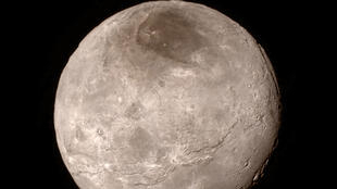Image released July 15, 2015 by NASA shows new details of Pluto's largest moon, Charon.