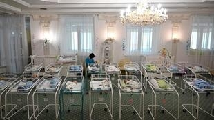 Dozens of babies born to surrogate mothers in Ukraine are waiting to be collected by their parents
