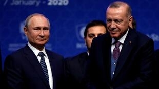 Russian President Vladimir Putin (left) and Turkish President Tayyip Erdogan attend a ceremony marking the launch of the TurkStream pipeline, which will carry Russian natural gas to southern Europe through Turkey, in Istanbul, Turkey, on January 8, 2020.