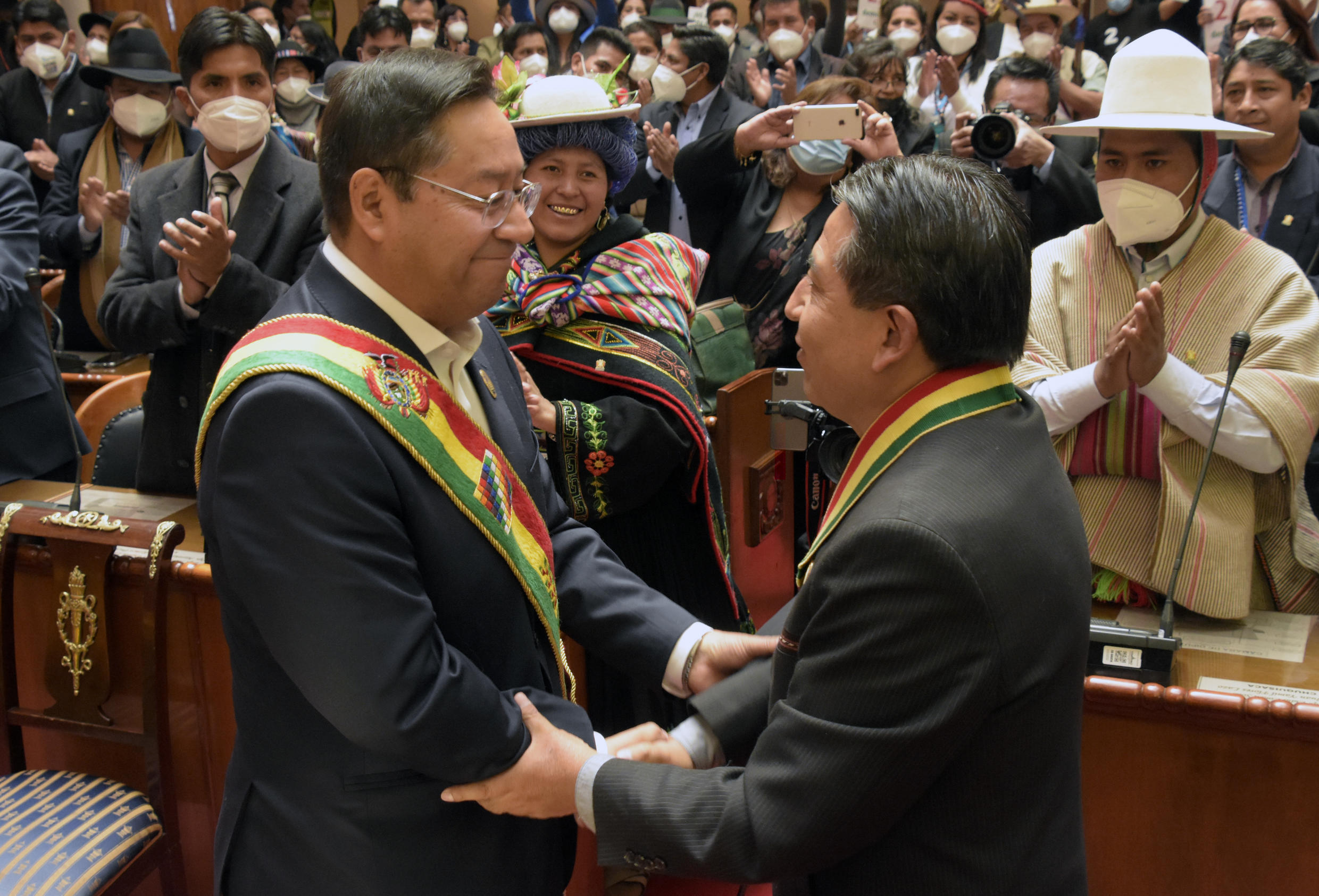 Luis Arce (L) and Vice President David Choquehuanca greet one another at a swearing-in before parliamentarians and foreign dignitaries in La Paz on November 8, 2020
