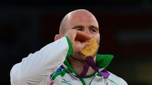 Wrestler Artur Taymazov has been stripped of the gold medal he is seen kissing here at the 2012 London Olympics