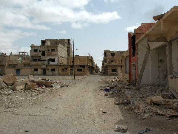 Some buildings in Palmyra's modern town were reduced to rubble after days of fighting between the Islamic State group and Syrian government forces backed by Russian air strikes.