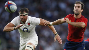 France's scrum half Morgan Parra (R) passes the ball during a Rugby World Cup warm up match between England and France at Twickenham Stadium, west of London on August 15, 2015