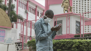 A man wears a face mask for protection outside a hospital in Yaoundé, Cameroon on March 6, 2020