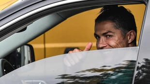 Cristiano Ronaldo drives away from Juventus' training ground in Turin after his first day back in over two months.