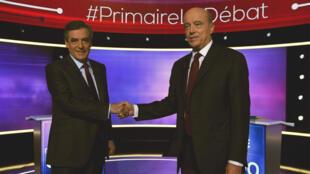Alain Juppé et François Fillon, jeudi 24 novembre 2016, lors du débat de l'entre-deux-tours de la primaire de la droite et du centre.
