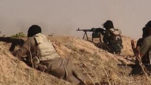 Image publiée par l'EIIL montrant des combattants djihadistes, le 13 juin 2014