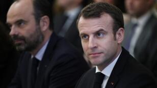 Le président Emmanuel Macron et le Premier ministre français Edouard Philippe, au palais présidentiel de l'Elysée à Paris, le 10 décembre 2018.