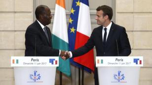 Alassane Ouattara et Emmanuel Macron lors d'une conférence de presse commune à l'Élysée, dimanche 11 juin 2017.