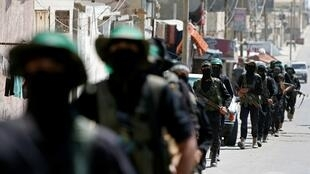 Palestinian Hamas militants march on a street at Beach refugee camp in Gaza July 16 2020 REUTERS