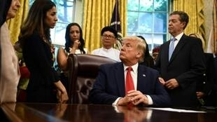 US President Donald Trump speaks with Nobel laureate Nadia Murad during a meeting in the Oval Office with survivors of religious persecution